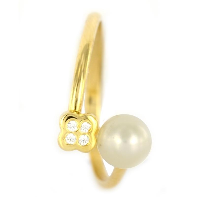 Anillo oro 18k, perla circonita